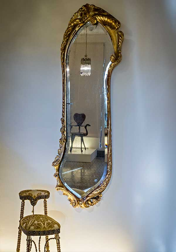 Mirror and 'voyeuse' chair from the living room on the main floor at Casa Calvet